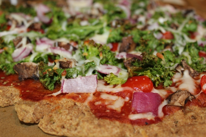 Kale, mushroom, and red onion pizza on whole wheat crust