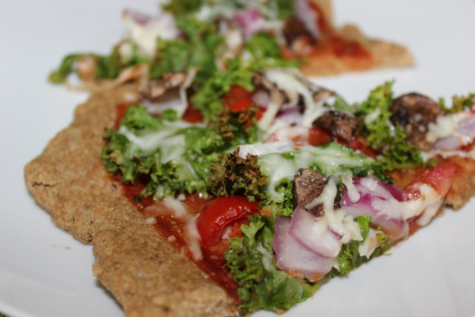 Kale, mushroom, and red onion pizza